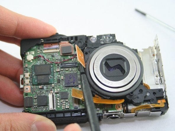 Remember the first ribbon was removed while taking out the flash assembly.