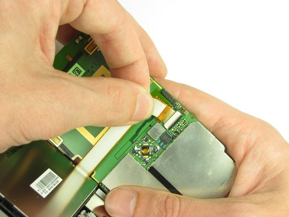 Gently pull on the ribbon cable to separate the motherboard.