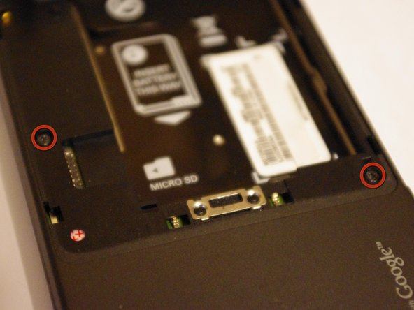 Remove the two T5 screws as shown by the markers.