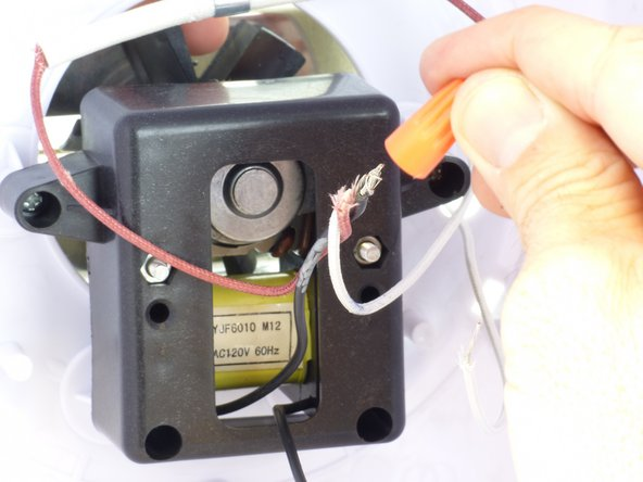 Push the wire cap onto the exposed ends while holding the wires and twist in a clock-wise direction until it is tight.