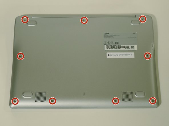Remove the nine 5 mm screws on the bottom cover using a Phillips #0 screwdriver.
