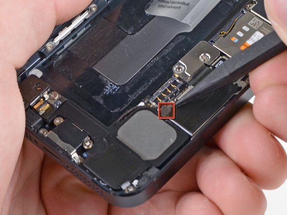 Use the tip of a spudger to pry the cellular data antenna cable connector up from its socket on the logic board, just above the speaker enclosure.