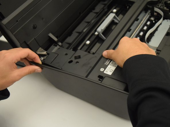 Remove right side of the printer using a plastic opening tool or metal spudger.
