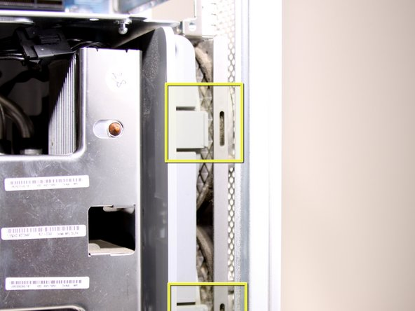 Image 1/2: After the latches are out, pull the fan out.