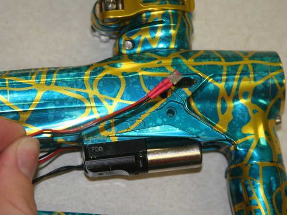 Gently pull out the two eyes, one on each side of the paintball marker.