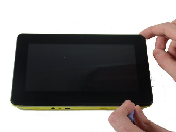 "Press the plastic opening tool in until you hear a ""click"" and that part of the tablet opens."