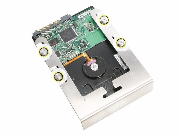 If you are replacing the hard drive with a new drive, remove the four screws that mount the 3. drive to the carrier and mount the new drive in the carrier.