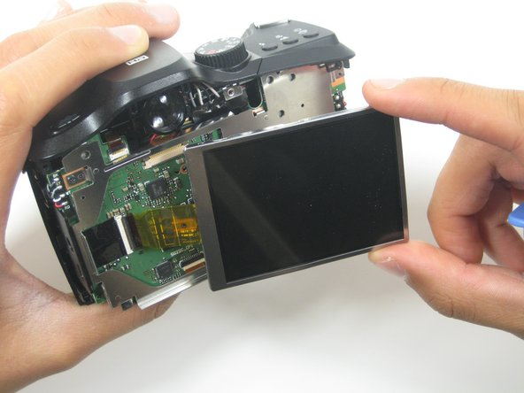 Gently remove the LCD screen from it's interior casing by lifting and pulling from the right side.
