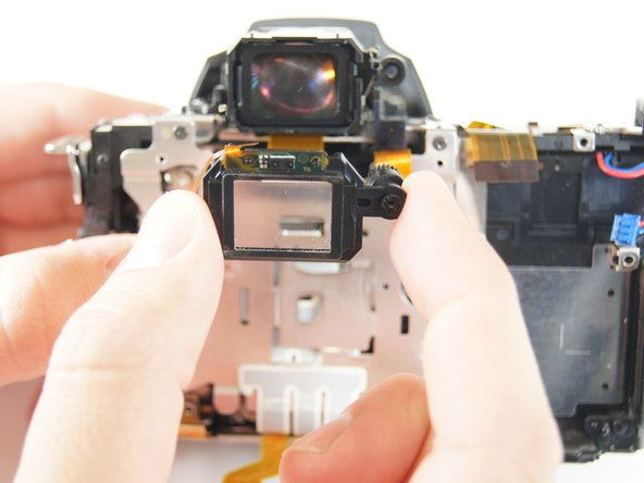 Image 2/3: Gently remove the eyepiece sensor from the viewfinder.