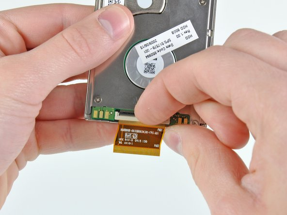 Use your fingernail or the flat end of a spudger to flip up the retaining flap on the hard drive cable ZIF socket.