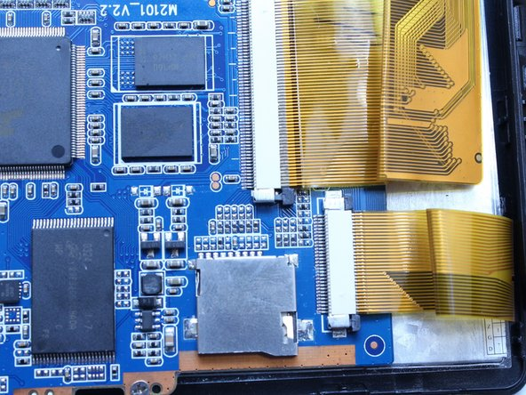 Image 2/3: Gently pull and remove the ribbon cables from the motherboard