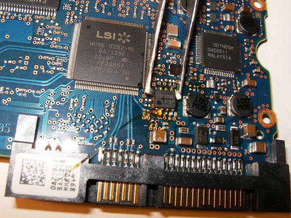 Image 1/3: Solder the BIOS IC into place