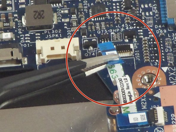 Use a pair of tweezers to disconnect the motherboard-side of the SD board ribbon cable. Gently lift up the black tab, and then ribbon cable should come free from the ZIF connector.