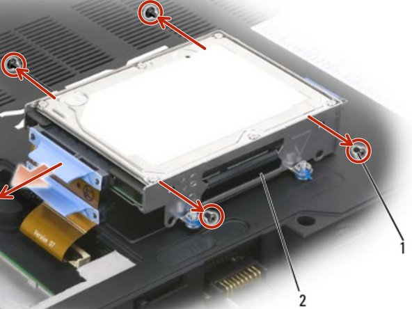 Remove two screws on each side of  the hard drive cage to free the hard  drive, then lift the drive out of its tray in the cage.
