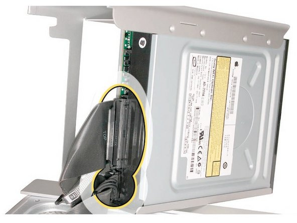Disconnect the power and ribbon cables from the optical drive(s) and remove the carrier.