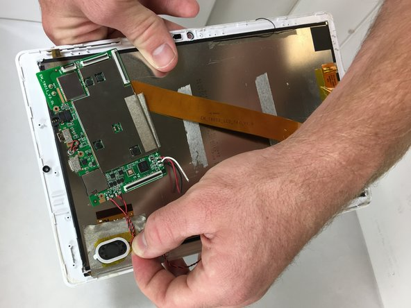 Remove the speakers from the tablet by gently pulling the yellow tape up from the front case.