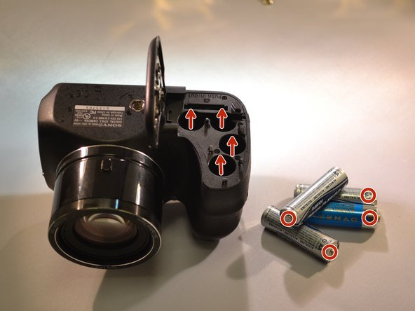 Take the four AA batteries out of the battery compartment.