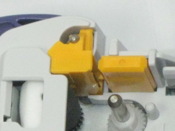 Locate the yellow cutter blade unit as shown in the photo.