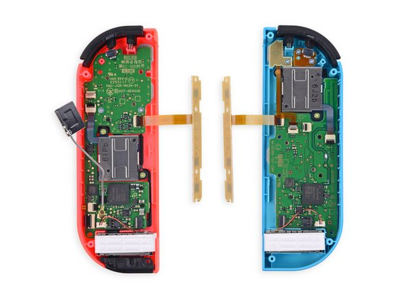 Image 1/3: We aren't shallow—it's what's inside that counts. The red Joy-Con comes out ahead with IR hardware and an NFC antenna.