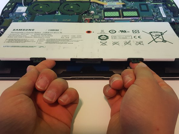 Lift the battery with both hands and remove.