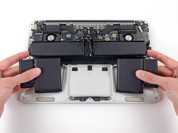 Before installing a new battery, remove all the old adhesive from the MacBook Pro's case.