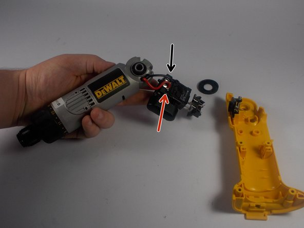 Carefully detach the solder points where the trigger assembly is attached to the motor assembly.