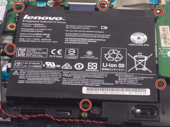 Locate the six 3.5mm Phillips head screws along the edges of the battery.