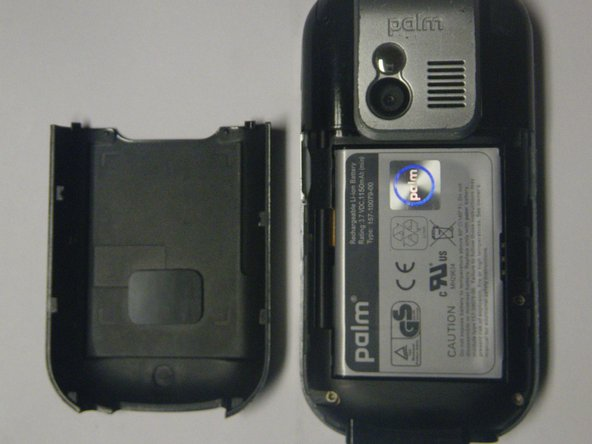 Press and slide open the battery cover.