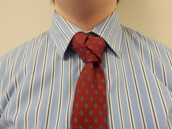 Tuck the rest of the narrow end into your collar and fold your collar down.