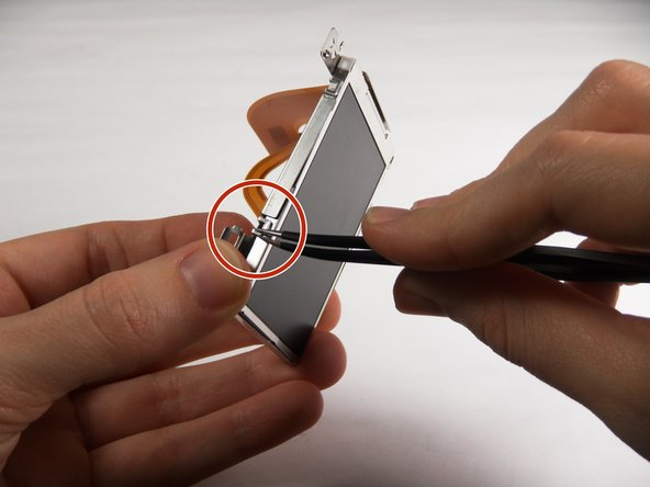 Image 1/2: Use your thumb to hold the Outer Frame open.