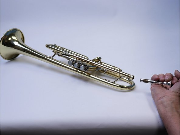 Be careful when  removing the parts. If any part becomes bent or damaged in any way the trumpet may require more professional repair.