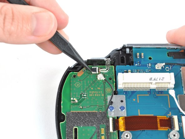 Release the right shoulder button flex cable socket by using a spudger to gently pry open the tab.
