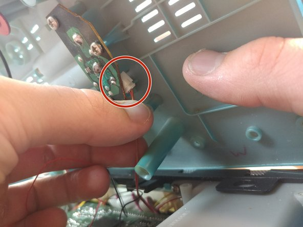 Disconnect the next connector pin after slowly opening the lid more.