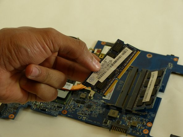 Install your new RAM memory card.