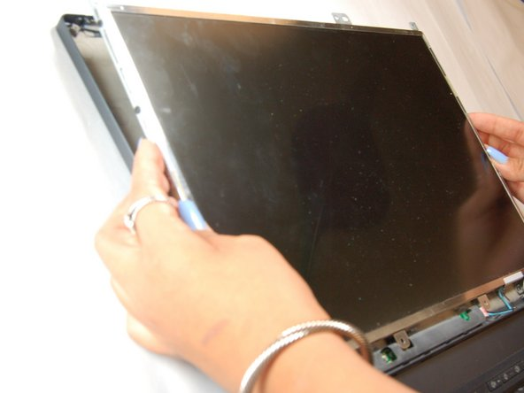 Image 1/1: The laptop will still be connected to the monitor wires located at the bottom of the screen.