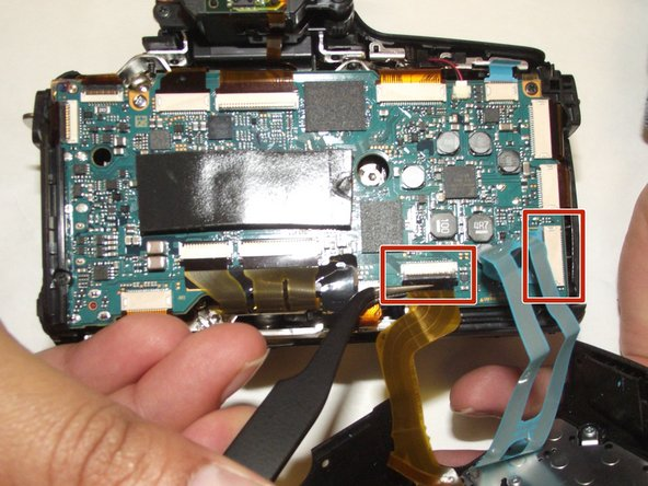 Using tweezers, gently remove the ribbon cables.