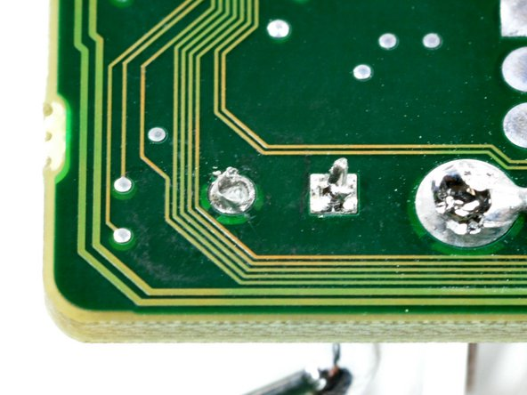 Image 2/2: Pushing the tool all the way through the hole may require heating the pad several times. As a rule of thumb, heat the solder just enough for it to melt, then remove the soldering tip from the pad. Excessive heat will damage electronic components.