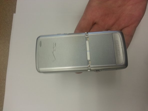 Using your thumb, slide the cover away from the device, and then place the cover to the side.