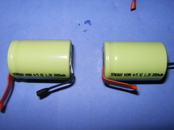 Position the last two battery so that the polarity matches the way the connect to the back of three.