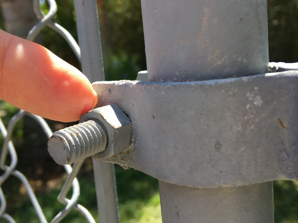 Tighten the nut on the gate hinge straps.