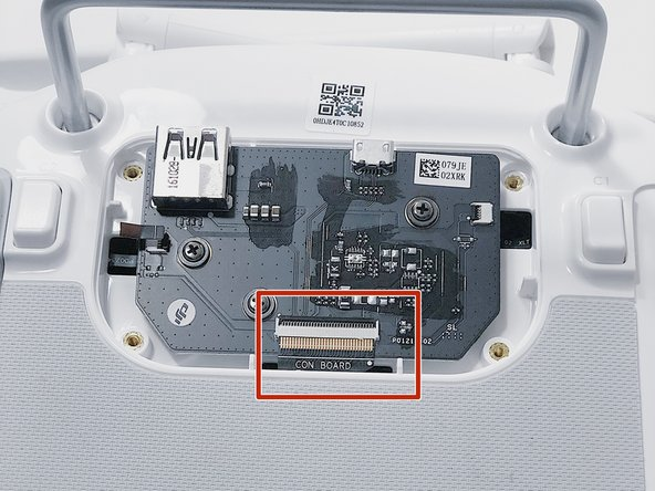 With tweezers, gently remove the large con board tab.