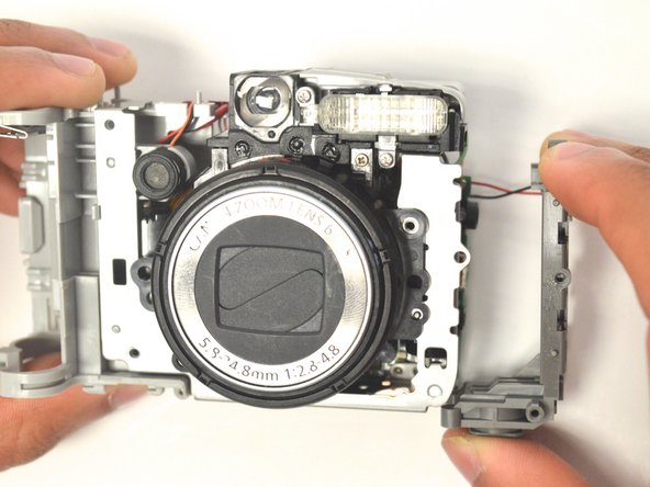 Use the screwdriver to remove the two 3.5 mm Phillips screws from the lens metal frame.