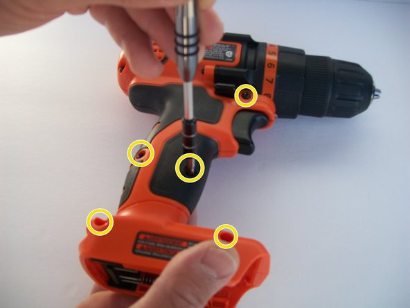 Remove the five  screws on the front side of the drill.
