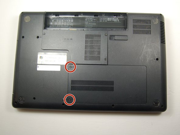 Find the hard drive compartment with two Phillips head screws.
