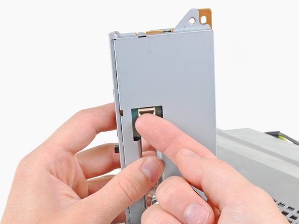 Lift the memory card reader out of the PS3 enough to access its cable.