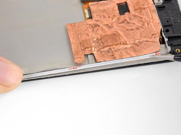 Use the narrow rectangular strips to secure narrow edges, like those on a display.