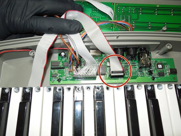 Image 1/3: Prior to removal, note, mark, or take photo's of the position of all connectors, specifically note the side that the red wire is on, as ribbon cables are polarized cables that must be installed correctly. installing the cables backwards may cause damage to the device or significantly hinder the troubleshooting process.