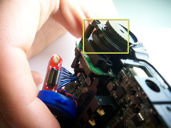 Image 1/2: Be sure to note how the part is attached so that you can replace it correctly.