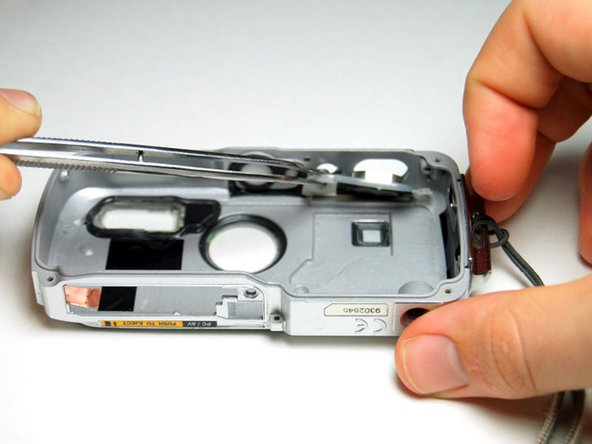 Remove the shutter and power buttons with the tweezers.