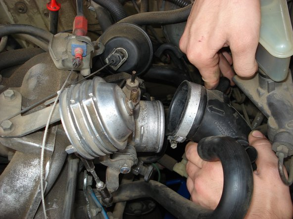 Remove the intake tube from the throttle body.